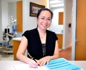 Jennifer Pham DDS at the desk