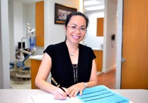 Jennifer Pham DDS at the desk